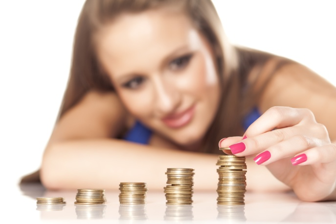 beautiful smiling girl  line up coins in pillars