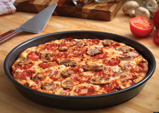 Try Domino's New Handmade Pan Pizza Made From Fresh, Never-Frozen Dough! (PRNewsFoto/Domino's Pizza)